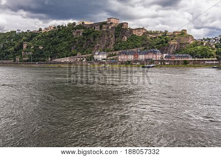COBLENZ/GERMANY - JUNE 232012: Fortress Ehrenbreitstein on cloudy day on the side of river Rhine in Koblenz Germany