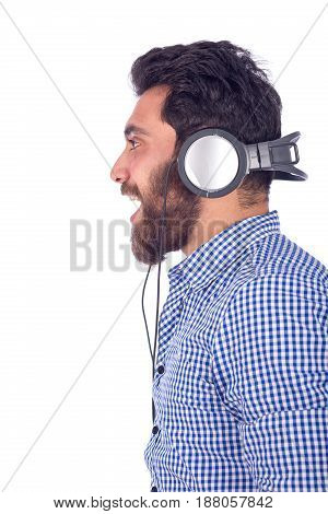 smiling beard yung man listening to music and looking side guy wearing blue shirt isolated on white background