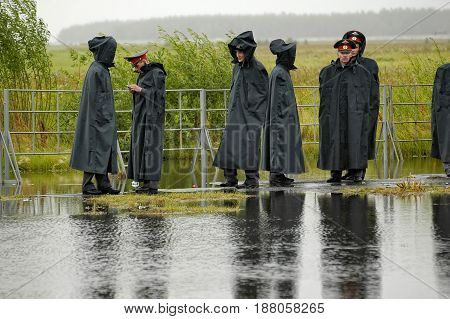Tyumen Russia - July 30 2006: City Day. Police officers stand in cordon in rainy weather
