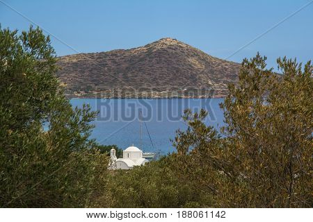 A small white church on the shore of the Gulf of Mirabello. Crete. Greece