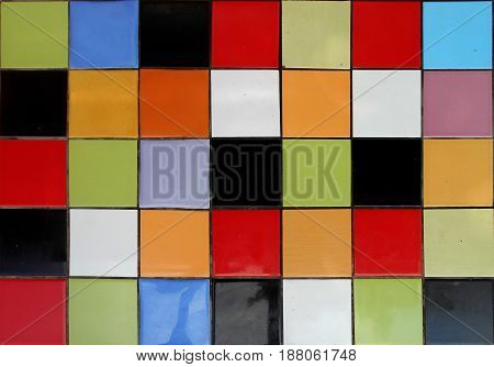 Background made of ceramic tiles in various colours, seven columns with five squares in each
