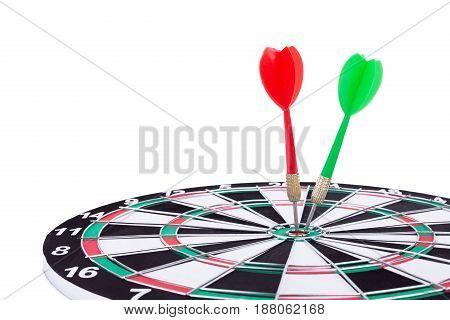 Red and green dart arrows targeting the center of Dart board Isolated on white background