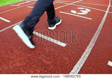 Red Running Racetrack On The Stadium With Run Legs