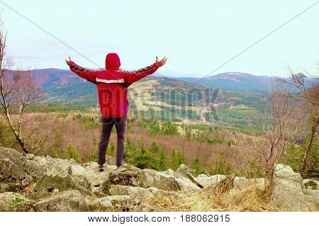 Man Stand On A Rock In A Cold Windy Spring Day. Active Lifestyle, Outdoor Activities, Hike
