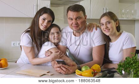 Happy Family at Home in Kitchen, Smile and Looking at Camera.