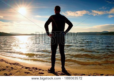 Silhouette Of Sport Active Adult Man Running And Exercising On The Beach. Calm Water