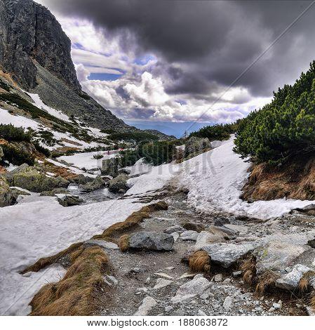 Creek and footpath near waterfall Skok High Tatras mountains. Slovakia.