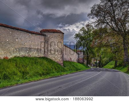 Old Cathedral wall and road spring cloudy midday (Spisske Podhradie Slovakia)