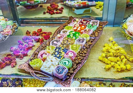 The plate with different variaties of Turkish delight (rahat lokum) - traditional sweet food consisting of gel of starch sugar dry fruits nuts mint rose water and many others Kemer Turkey. poster