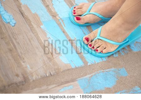 Lady's Feet In Sandals On Beach