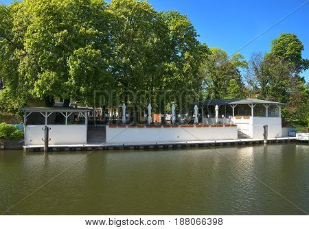 Quiet and cozy restaurant with a pier, on the bank of a wide river