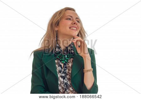 Portrait of chic young blondes in a green jacket that keeps your hand near the Chin looks away and smiling isolated on white background