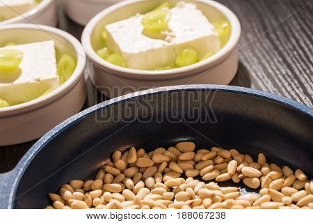 Pan with rosted pine nuts for a dessert.