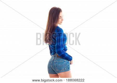 Sexy brunette in short shorts and blue shirt isolated on white background