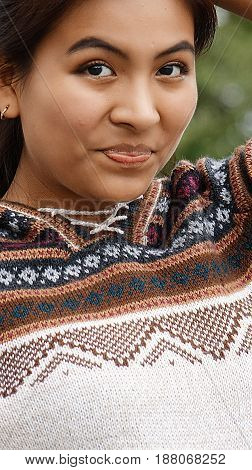 A Latina Teenage Female Wearing A Sweater