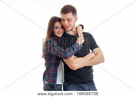Cheerful young couple in love huggin and smiling isolated on white background