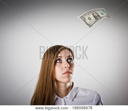 Woman in white and falling one dollar.