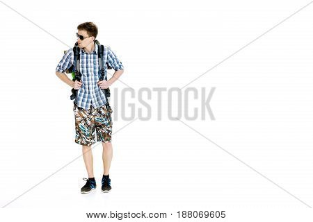 Young hiker in sunglasses with a backpack on a white background
