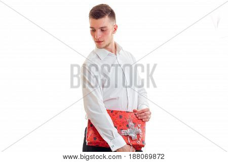 young cute guy with a gift in the hands isolated on white background