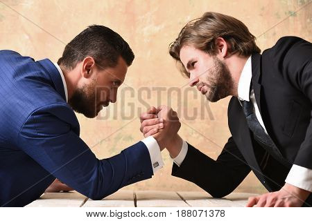 partnership and teamwork arm wrestling of businessman and compete man co workers and dominance
