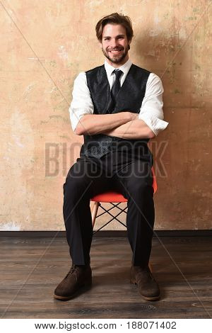 man or smiling businessman in business suits it on chair waiting for job interview