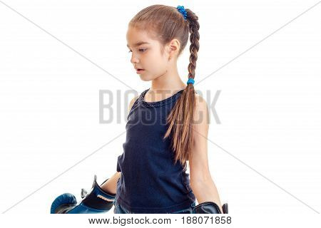 young girl in boxing gloves practicing isolated on white background
