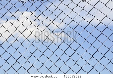 Sky behind the fence. The concept of freedom security loneliness imprisonmentrefugee