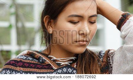 A Worried Female Wearing a Knit Sweater