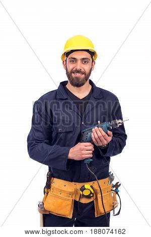Smiling beard young worker holding driller man wearing workswear and belt equipment isolated on white background