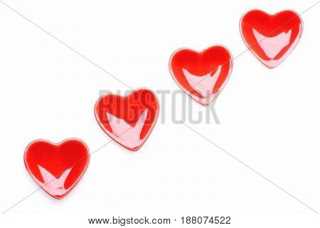 Ceramic Shiny Hearts In Red Colour Placed In Diagonal Line