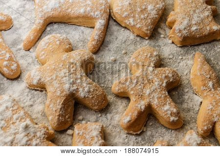 Cookies In The Form Of Men, Animals And Snowflakes On A Baking Sheet