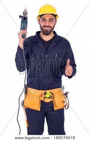 Smiling beard young worker feeling satisfied and holding driller man wearing workswear and belt equipment isolated on white background