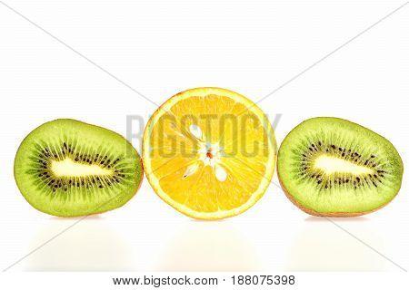 Fruit Trio Composition Made Of Kiwi Fruit And Orange Halves