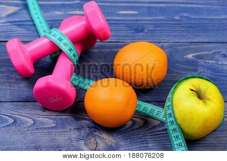 Measuring Tape, Dumbbells Weight And Apple, Orange For Diet Concept
