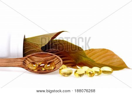 Fish Oil Omega 3 Gel Capsules In Spoon With Leaves