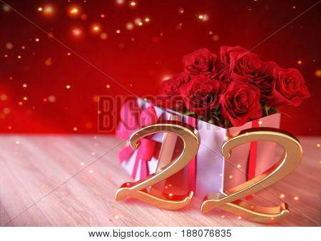 birthday concept with red roses in the gift on wooden desk - twenty-second birthday. 22nd