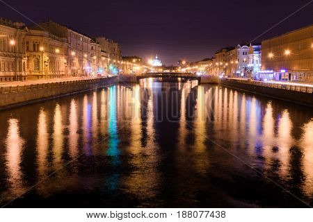 View of Lomonosov bridge across the Fontanka river Saint-Petersburg at night