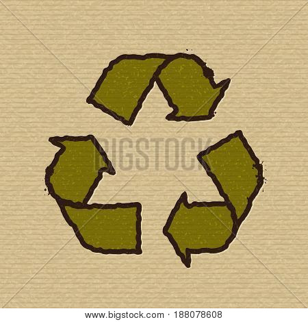 Symbol of recycling on texture of brown packing cardboard.