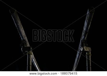 Closeup. Gymnastic parallel bars. Isolated on black background
