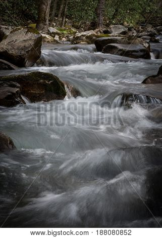 Long Exposure Of Rushing Water Over Rocks