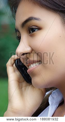A Female Youngster Using A Cell Phone