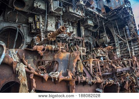 Rusty ruins of Russian sunken warship Indomitable (Neukrotimiy) raised from the bottom and sawed for scrap metal.