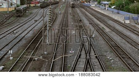 Many railroad track, aerial view of railroad station platform, freight transportation concept