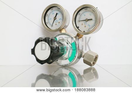Cylinder pressure regulator gauge isolated on a white background.