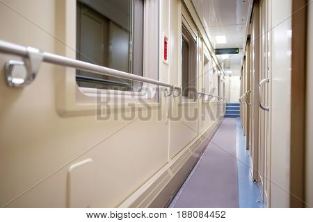 Corridor in the modern compartment car. Selective focus