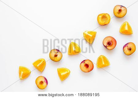 tropical peach and orange fruits for fresh summer juice on white table background top view space for text
