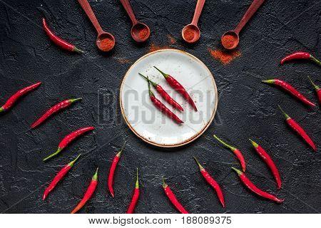 red hot chili pepper design on dark kitchen desk background top view