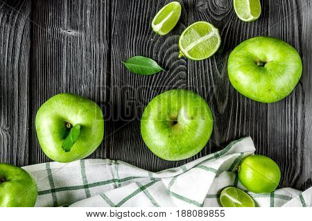 summer food with green apples on dark table background top view