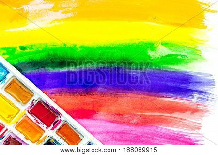 multicolored paint design with pallete for abstract artist texture background