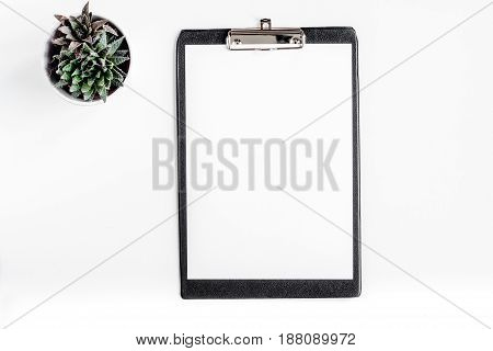 doctor's work desk in hospital with sketch-board on white background top view mockup